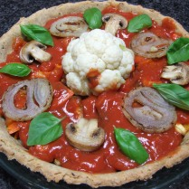 2. Spoon the tomato sauce over the veg and arrange mushrooms, onions and basil on top