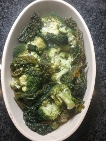 Put steamed broccoli and kale across the bottom of an oven proof dish